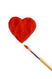 Drawn heart and brush Stock Image