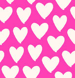 Drawn heart silhouettes on rose background Royalty Free Stock Photography