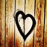Love. Drawn hearth on wooden surface Royalty Free Stock Image