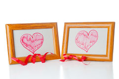 Drawn hearts  in the photo frames Royalty Free Stock Image