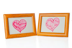 Drawn hearts  in the photo frames Stock Photo