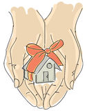 Drawn humans hand holding house with ribbon Royalty Free Stock Photo
