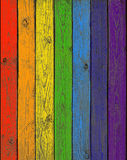 The boards of a fence painted in colors of a rainb Stock Photos