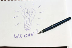 Drawn lightbulb idea and we can plus pen. 1 Stock Photo