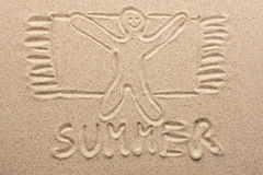 Drawn man on the sand stock image