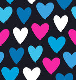 Drawn multicolor heart silhouettes on black background. Symbol of love in grunge style. Decorative seamless pattern Royalty Free Stock Images