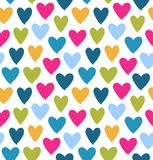 Drawn multicolor heart silhouettes on white background. Saint Valentine`s Day. Symbol of love on decorative seamless pattern Royalty Free Stock Photo