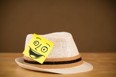 Post-it note with smiley face sticked on a hat Royalty Free Stock Photo