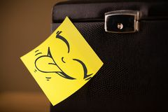 Post-it note with smiley face sticked on jewelry box Stock Images