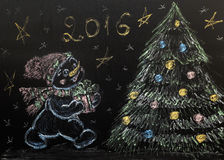 Drawn snowman with a Christmas tree on a black background. handmade Stock Photos