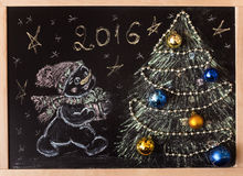 Drawn snowman with a Christmas tree on a black background. handmade Royalty Free Stock Photo