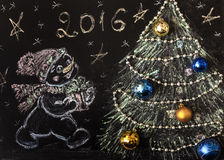 Drawn snowman with a Christmas tree on a black background. handmade Stock Image