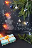 Drawn Snowman with falling snow and festive Christmas decoration Stock Image