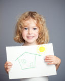 Drawn sun and house. In baby hands. Spring concept Royalty Free Stock Photography