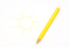 Drawn sun and lying pencil on a sheet of paper Royalty Free Stock Images