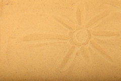 Drawn sun on the sand Royalty Free Stock Image