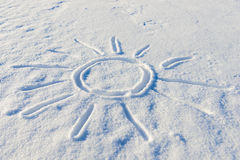 Drawn sun on snow Royalty Free Stock Image