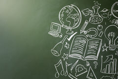Drawn symbols of school subjects on a chalkboard, copy space Stock Photo