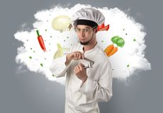 Vegetables on cloud with male cook. Drawn vegetables on cloud with male cook and kitchen tools royalty free stock photos