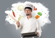 Vegetables on cloud with male cook. Drawn vegetables on cloud with male cook and kitchen tools stock photography