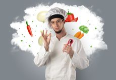 Vegetables on cloud with male cook. Drawn vegetables on cloud with male cook and kitchen toolsn Stock Photos