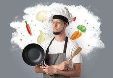 Vegetables on cloud with male cook. Drawn vegetables on cloud with male cook and kitchen toolsn stock photo