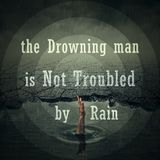 The drawning man is not troubled by rain Royalty Free Stock Image