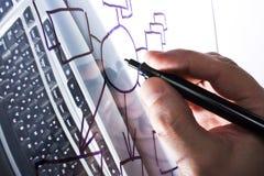 Draws a diagram on a transparent glass Stock Image