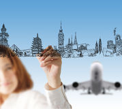 Draws dream travel. Female hand draws dream travel and aorplane Royalty Free Stock Photos