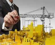 Draws golden building development concept. Business man hand draws golden building development concept Stock Image