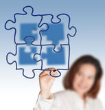 Draws puzzle diagram. Businesswoman hand draws puzzle diagram Royalty Free Stock Photos