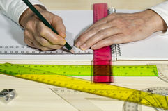 Draws with a ruler Royalty Free Stock Photography
