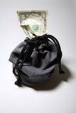 Drawstring bag with money. Drawstring bag containing paper money Royalty Free Stock Image