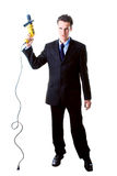 Dread businessman holding drill Royalty Free Stock Images