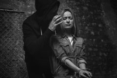 Dreaded cunning abductor threatening a woman Stock Photo