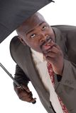 Dreaded day. Businessman facing his worst fears on a rainy day; versatile images for a number of employment issues.  Neatly isolated on white Stock Image