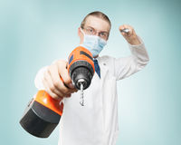 Dreadful dentist. Dentist with huge drill symbolizing fear of pain and dental treatment Stock Photo