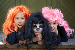 Dreadful friends. Portrait of three Halloween girls looking at camera with grins Royalty Free Stock Photos