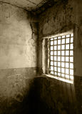 Dreadful prison cell. Old and ruined prison cell Stock Image