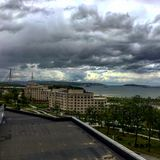 Dreadful sky above Russian Island. Amazing view of the Russian Bridge in Vladivostok and huge cloud above it Stock Image