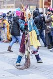 Dreadful witch mask with broom at Carnival parade, Stuttgart. STUTTGART, GERMANY - FEBRUARY 13:  dreadful witch mask with broom in parade. Shot  at  Carnival Stock Photography