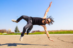 Dreadlocks guy breakdancing Stock Photo