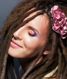 Dreads coiffure. Fashion female hairstyle. Flower Royalty Free Stock Image