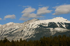 Dream. Jasper national park, alberta, canada, sunny weather, clouds over rocky mountains Royalty Free Stock Photography