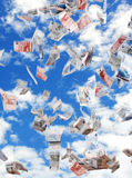 Dream. Flying papermoney in the blue sky Royalty Free Stock Images