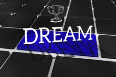 Dream against black keyboard with blue key Royalty Free Stock Images
