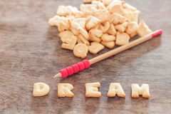Dream alphabet biscuit on wooden table Royalty Free Stock Images