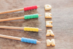 Dream alphabet biscuit on wooden table Royalty Free Stock Image