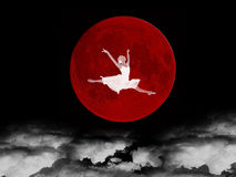 Dream Of The Ballerina. Illustration of the ballerina on a background of the red moon, above clouds in darkness Stock Photos
