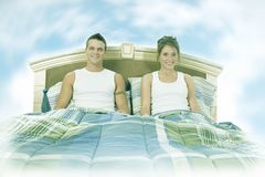 Dream bedroom. Couple in bed with blue sky in the background stock photos
